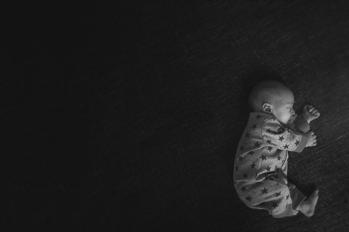tiny baby photo with lots of negative space by Kellie Bieser