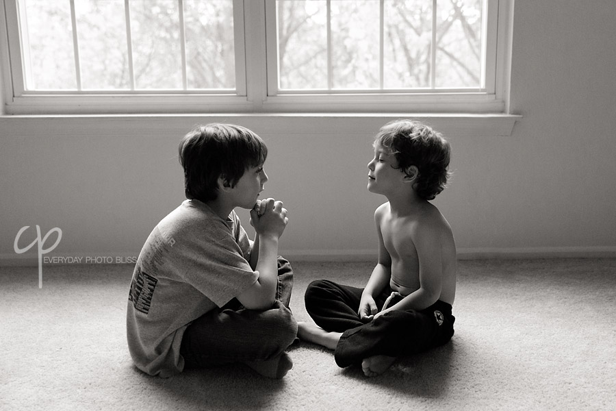 two brothers having a staring contest by Celeste Pavlik