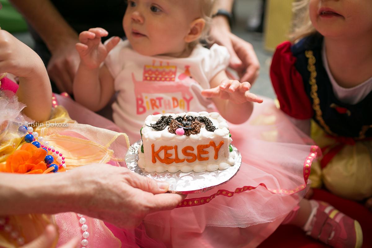 birthday girl with cake by Kristin Dokoza