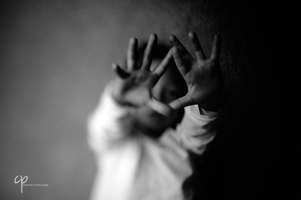 black and white freelens photo of boys hands by Celeste Pavlik
