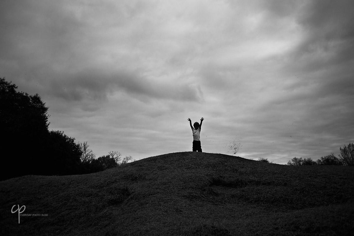 black and white portrait of boy on a hill by Celeste Pavlik