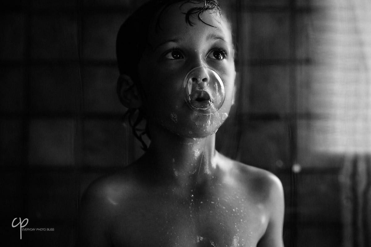 boy blowing a water bubble by Celeste Pavlik