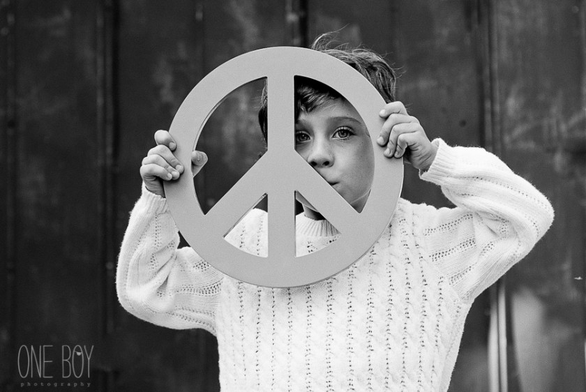 boy holding peace sign by Jan Tyler