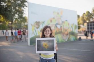 child holding her winning contest photo