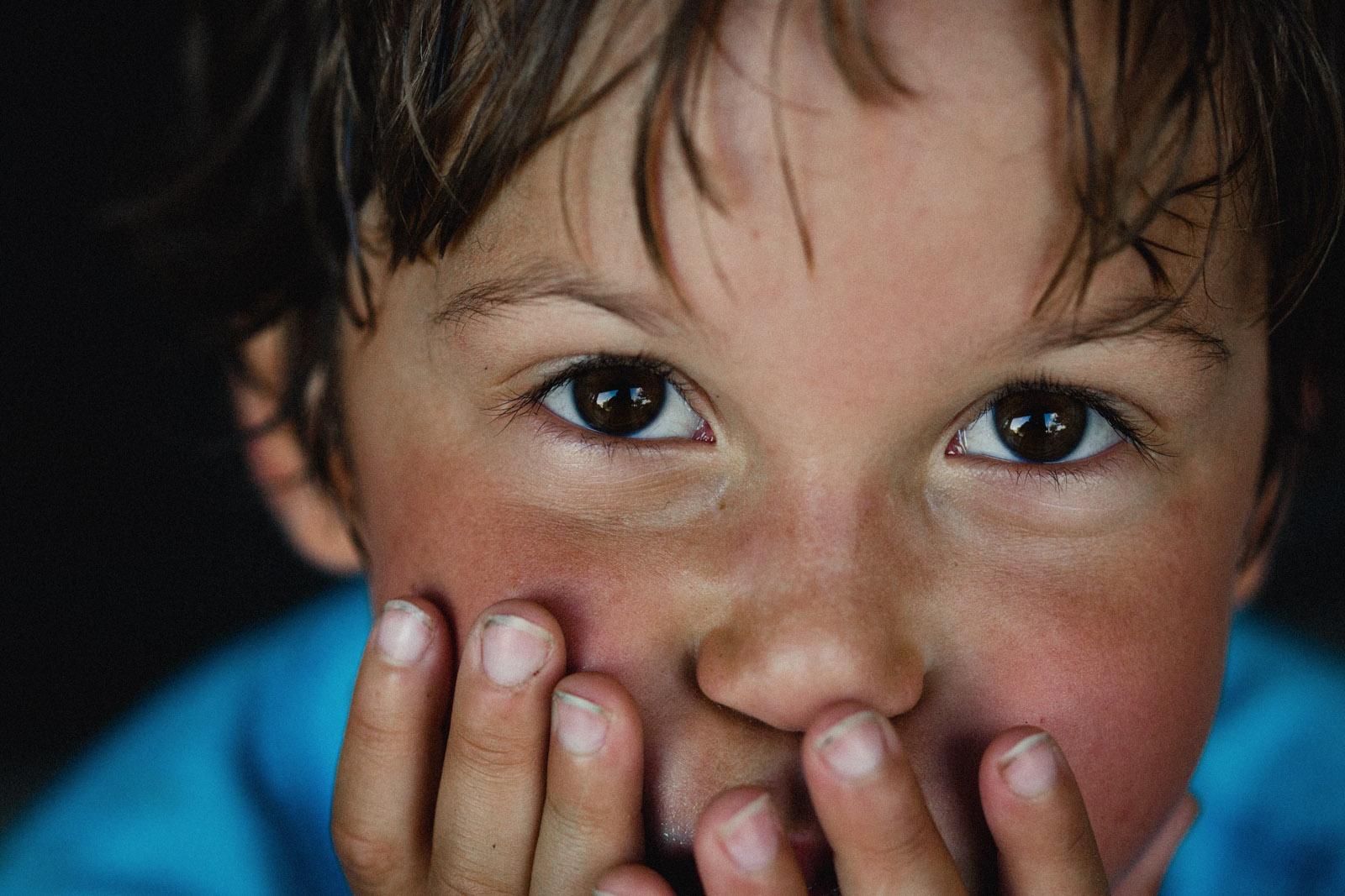 close up portrait of boy by Celeste Pavlik
