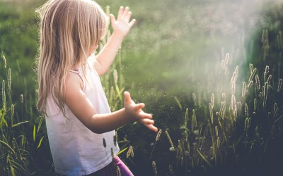 freelensing photo of girl in a field with beautiful light by Holly Donovan