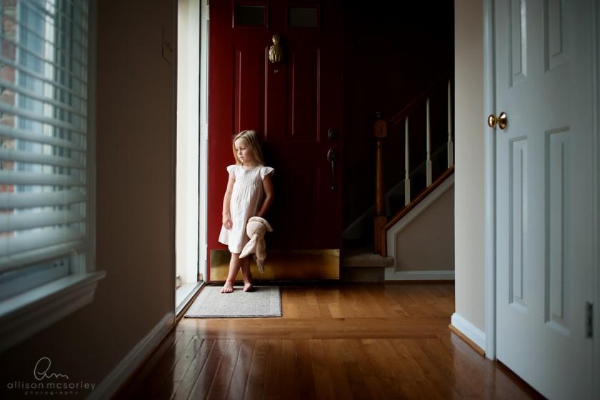 girl standing by front door by Allison McSorley