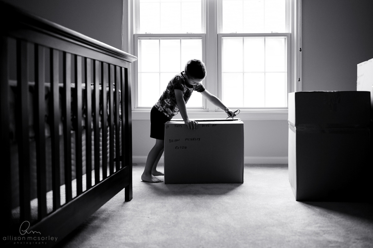 kid opening a box by Allison McSorley