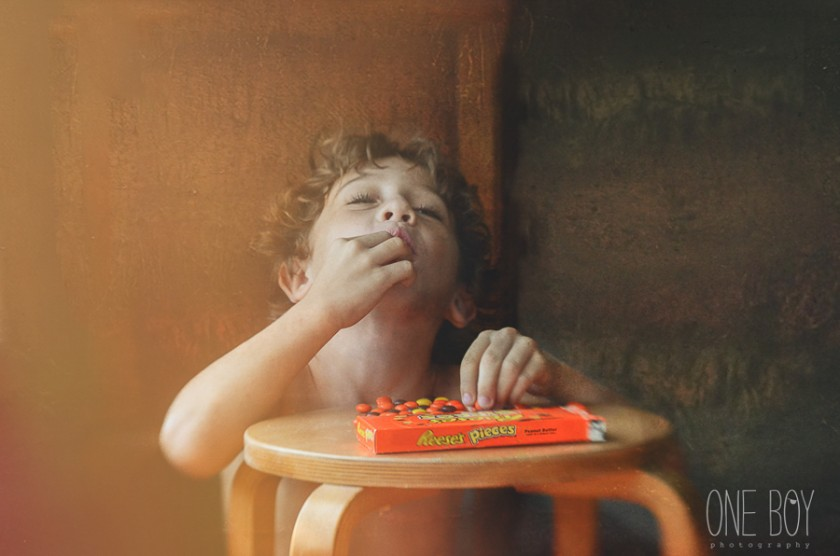 photo of boy eating reeses pieces by Jan Tyler