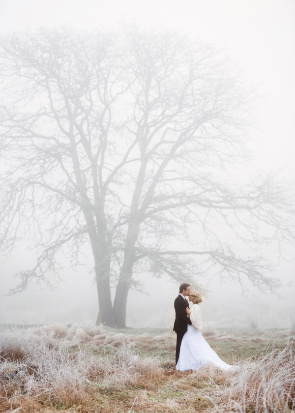 photograph of a bride and groom in a foggy field by Chloe Ramirez