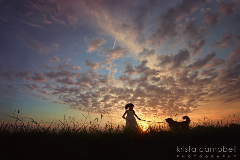 silhouette of young girl and her golden retriever by Krista Campbell