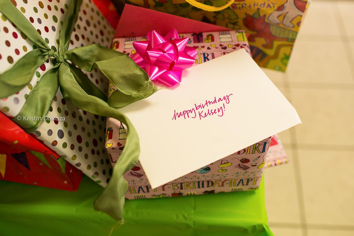 stack of birthday presents by Kristin Dokoza