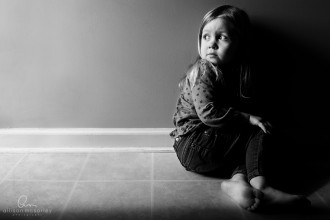young girl sitting on the floor by Allison McSorley