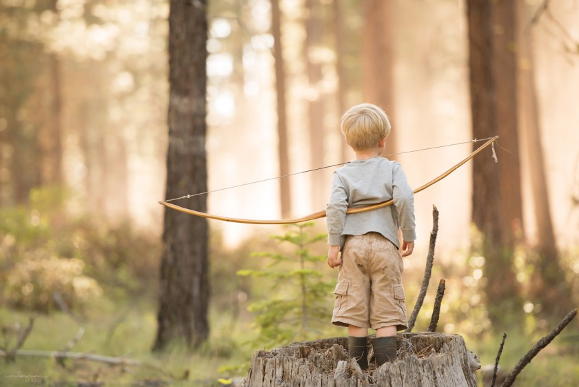 boy holding bow by Lacey Meyers