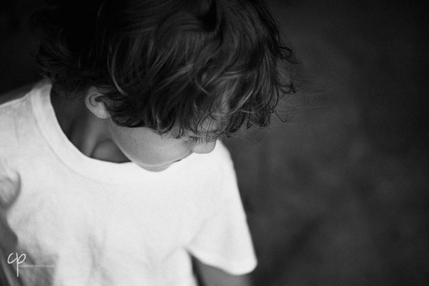 boy looking down by Celeste Pavlik