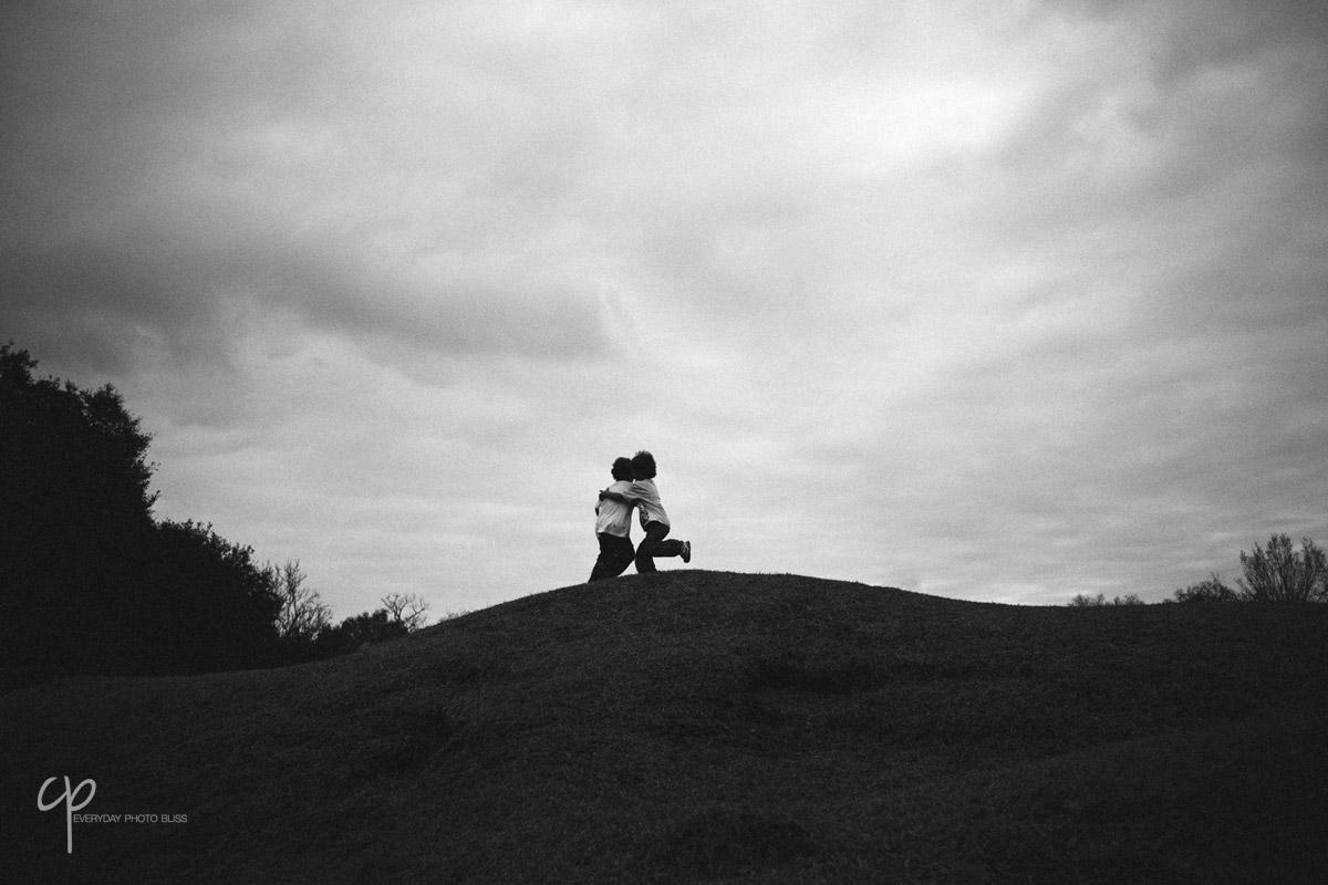 brothers hugging on a hill by Celeste Pavlik