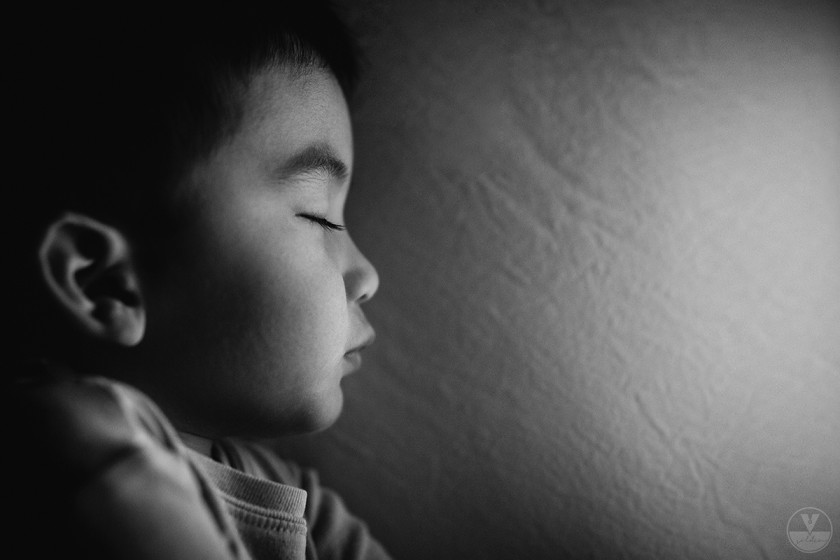 close up of boy sleeping by Vironica Golden