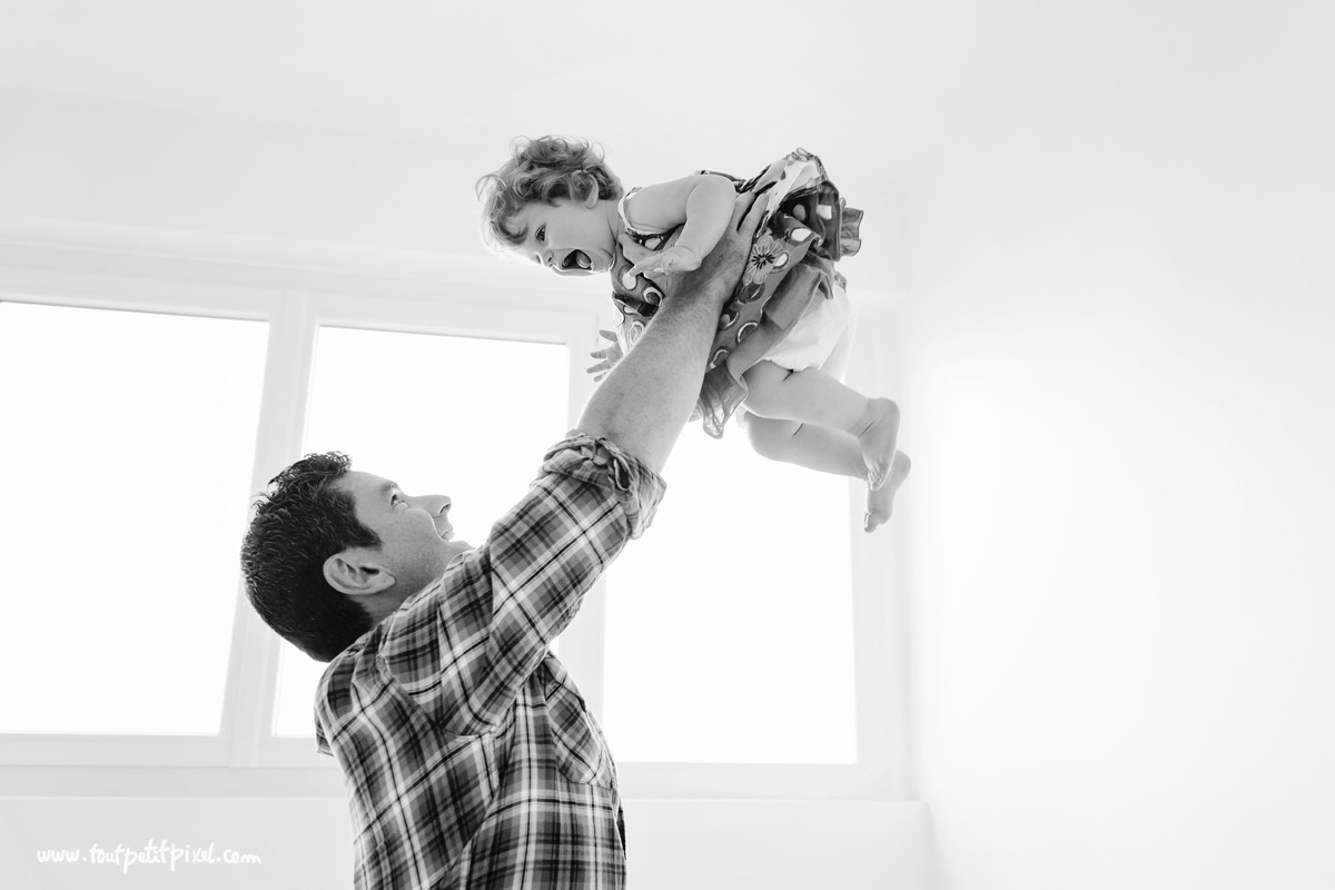 dad flying toddler by Lisa Tichane of Tout Petit Pixel