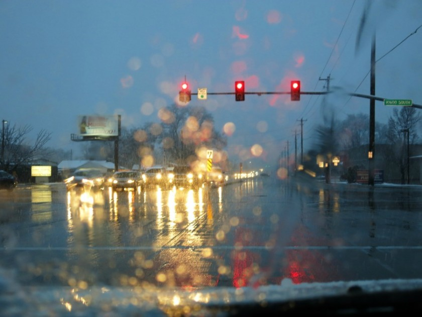 looking-through-car-windshield-at-stoplight-on-snowy-night-by-grandmabish