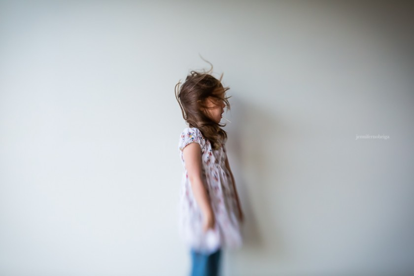 out-of-focus-hair-blowing-child-in-center-by-jennifer-nobriga