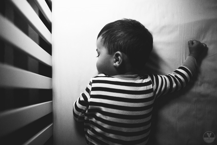 photo of boy sleeping from above by Vironica Golden
