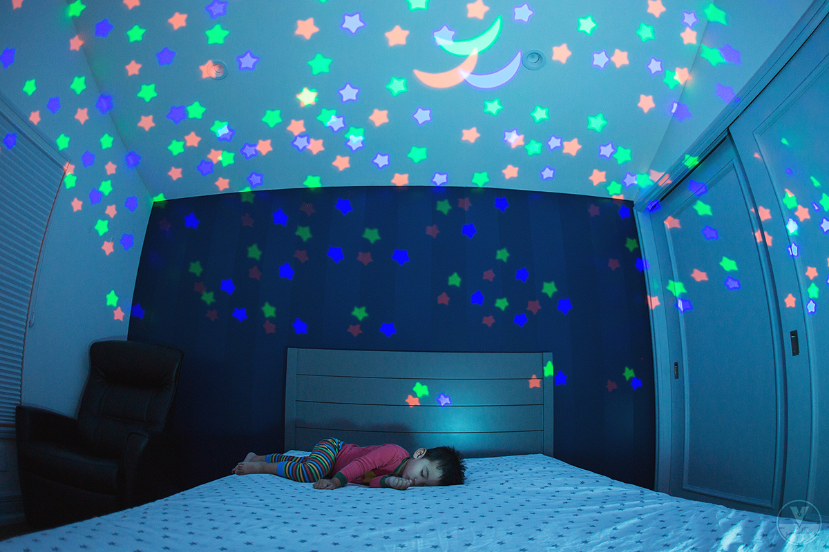 photo of boy sleeping with dreamlight lights by Vironica Golden