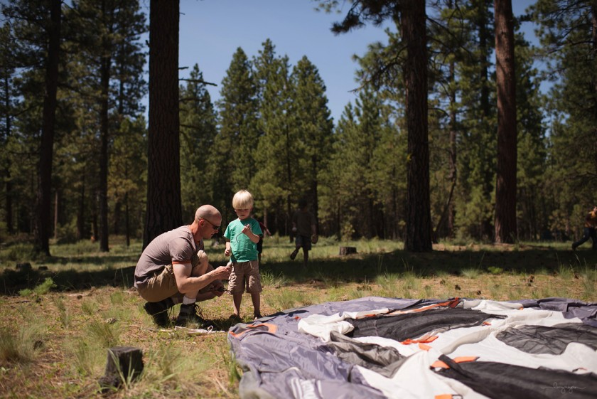 setting up a tent by Lacey Meyers