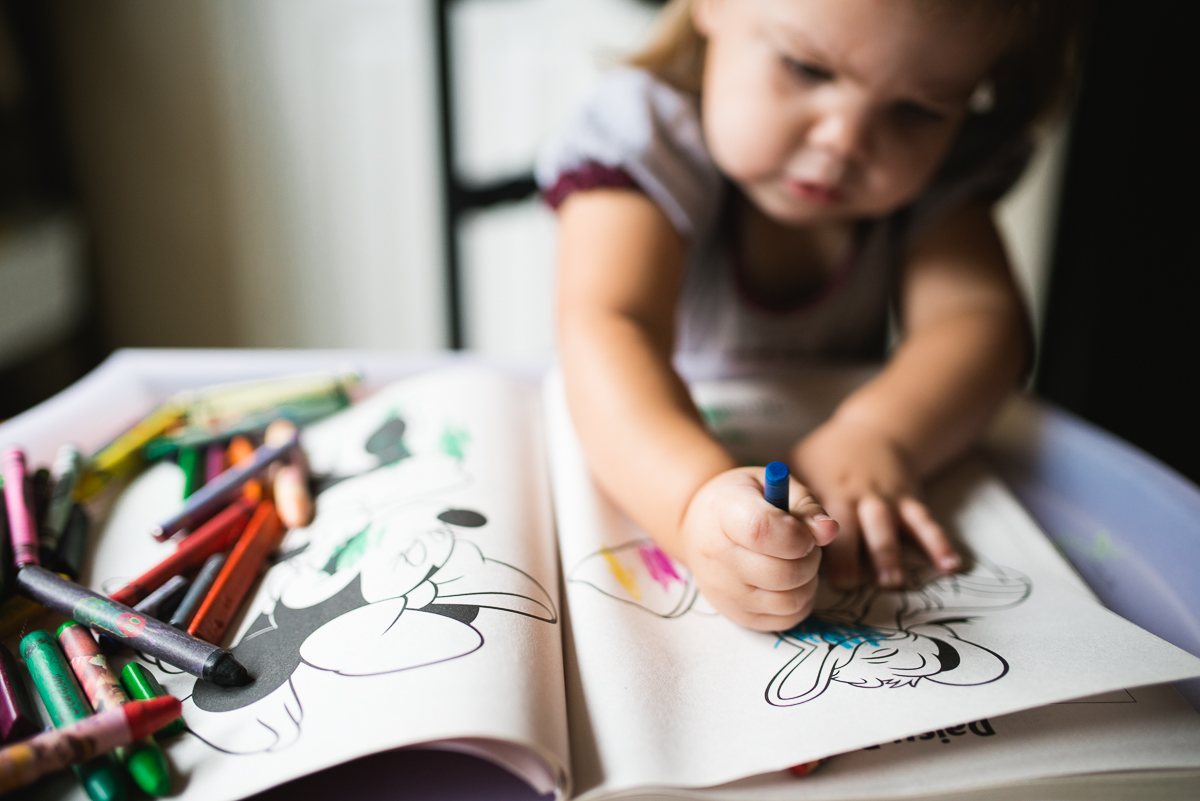 girl coloring donald duck by Sarah Carlson