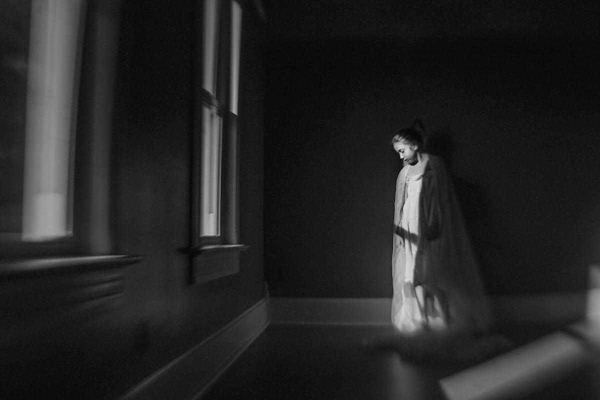 girl covered in natural window light by Caroline Jensen