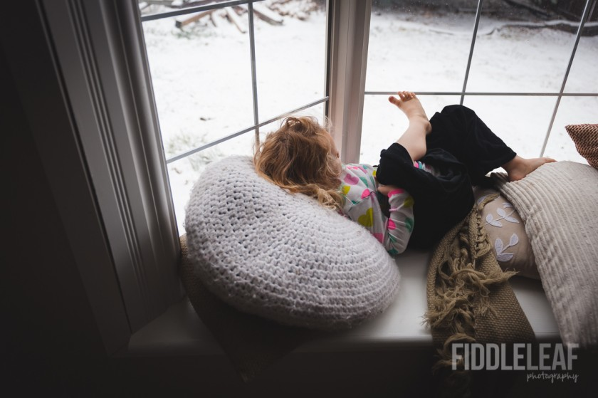 girl looking out window by Kelly Marleau of Fiddle Leaf Photography