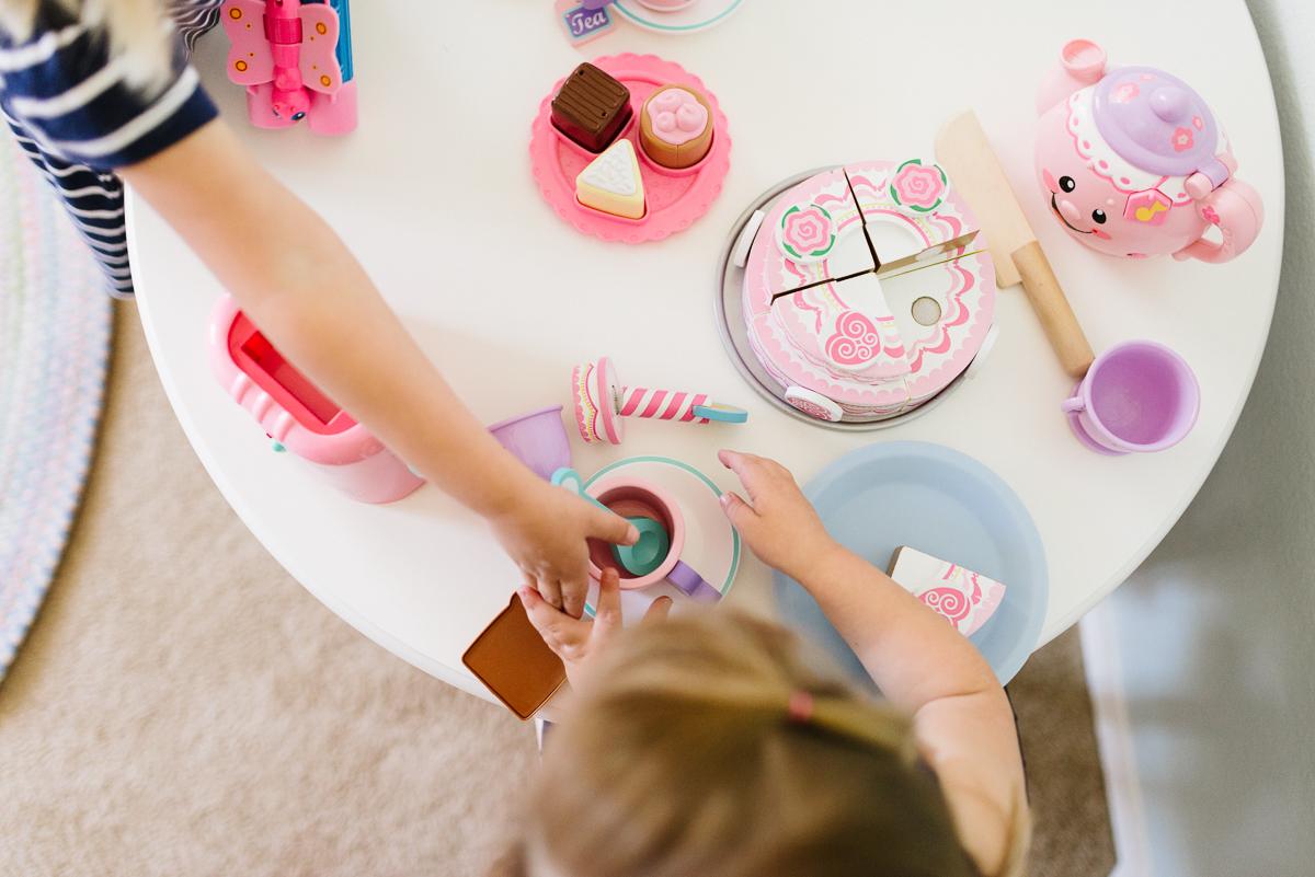 girls having a tea party by Sarah Carlson