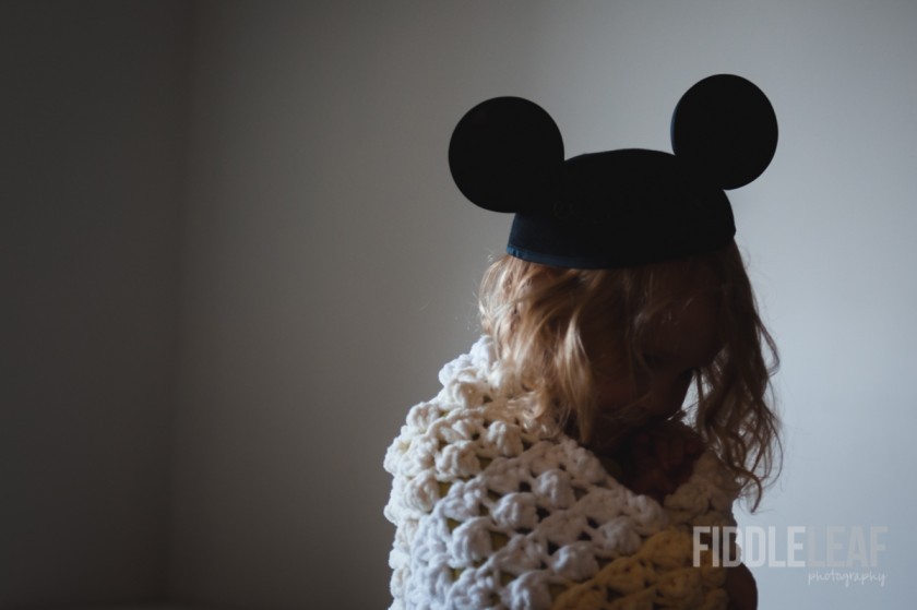 kid wearing Mickey Mouse ears by Kelly Marleau of Fiddle Leaf Photography