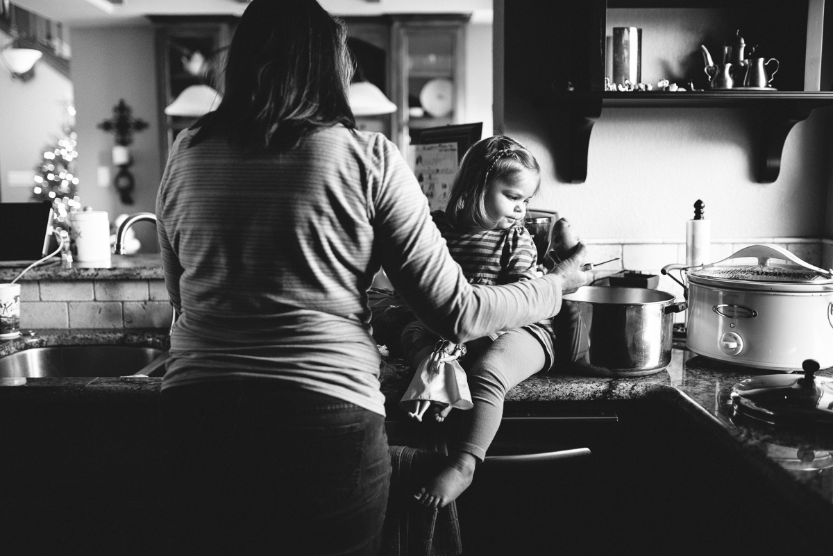 mom and daughter cooking by Sarah Carlson