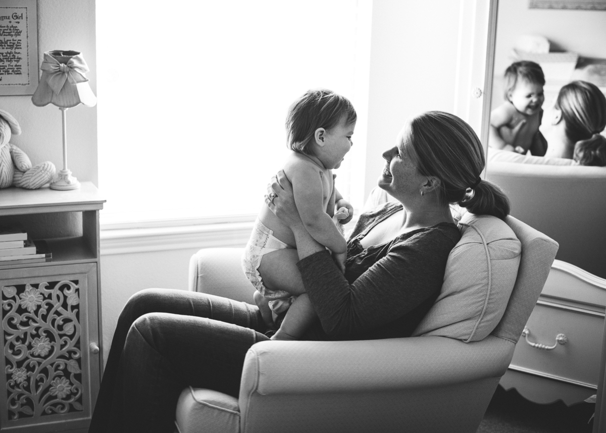 mom holding daughter by Sarah Carlson