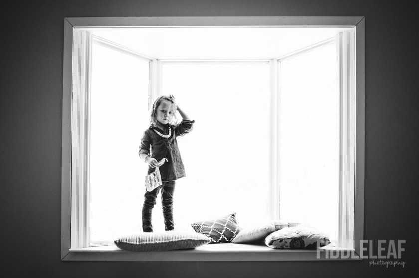 photo of girl in front of blown window by Kelly Marleau of Fiddle Leaf Photography