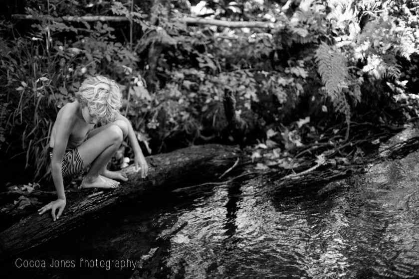 boy looking into the water by Thea Courtney of Cocoa Jones Photography