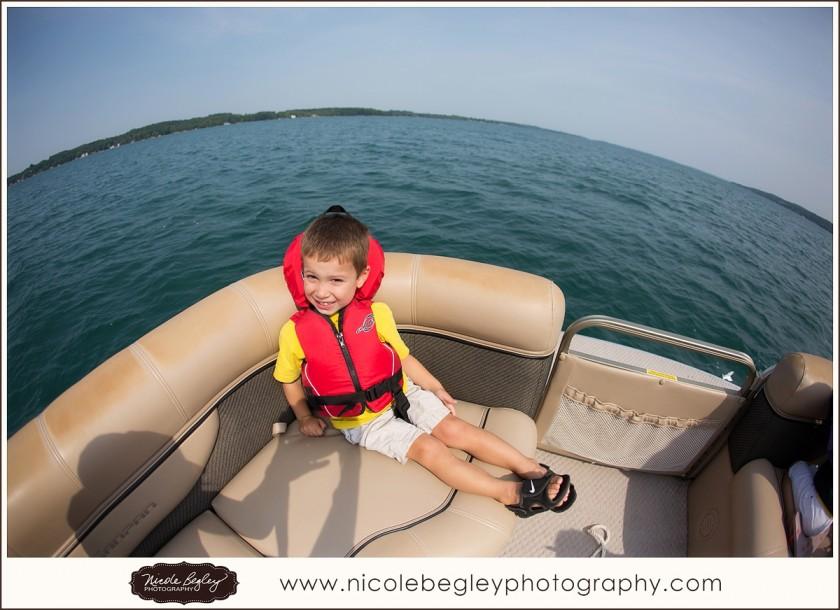 boy on a boat by Nicole Begley
