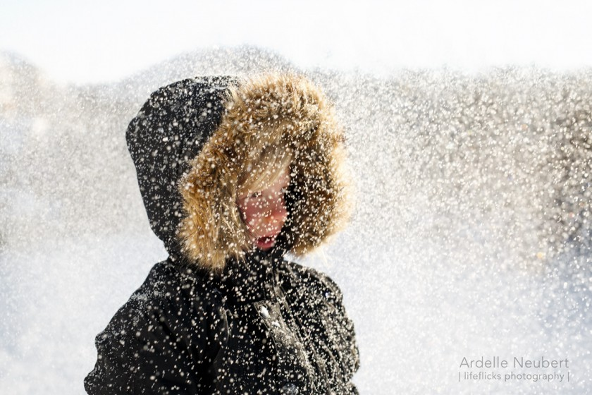 boy standing in the snow by Ardelle Neubert of Lifeflicks Photography