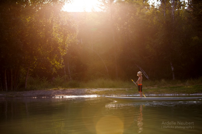child paddling a boat by Ardelle Neubert of Lifeflicks Photography