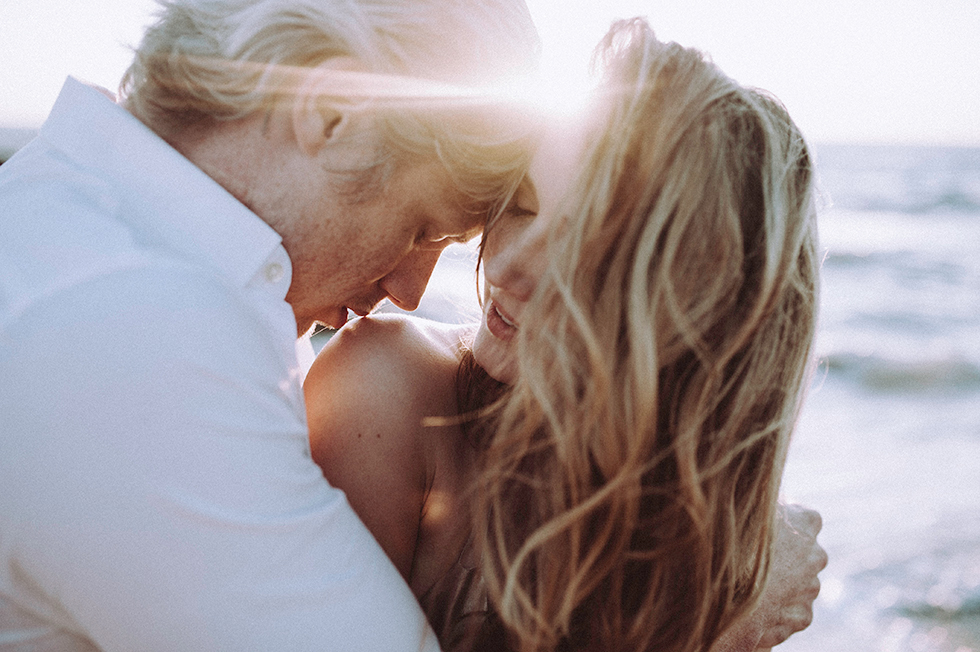 couple hugging by the beach by Candice Zugich of The Blissful Maven Photography