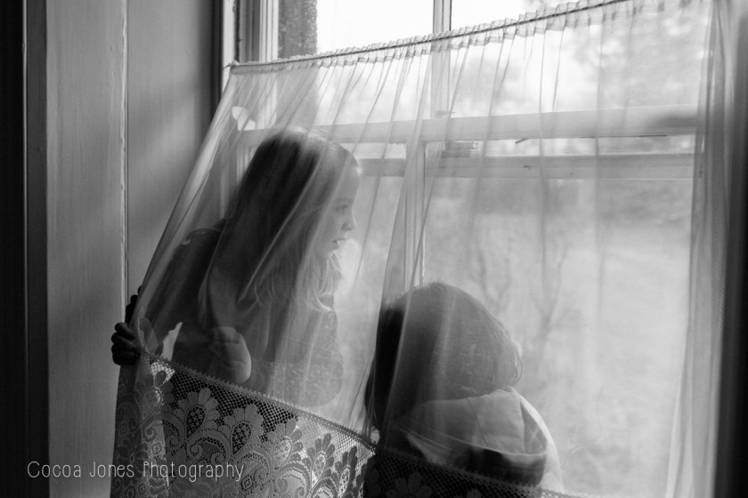 kids behind a curtain by Thea Courtney of Cocoa Jones Photography