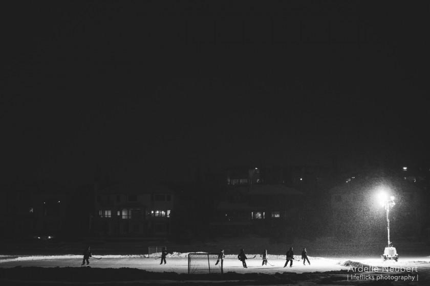 kids playing ice hockey outside by Ardelle Neubert of Lifeflicks Photography
