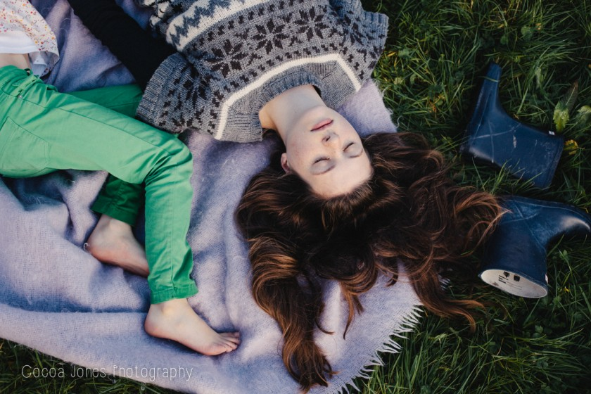 laying in the grass by Thea Courtney of Cocoa Jones Photography