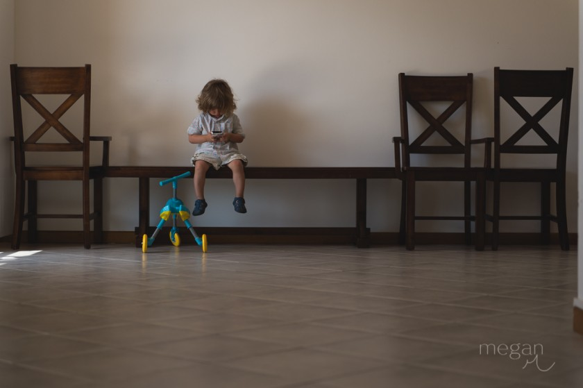 10 Toddler with iPhone in low light by photographer Megan Cieloha
