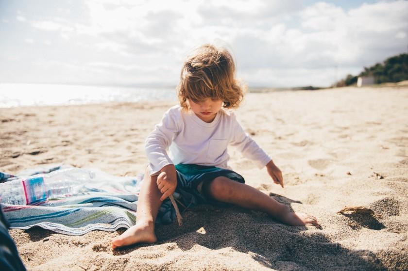 3 Baby boy in full sun on the beach by photographer Megan Cieloha