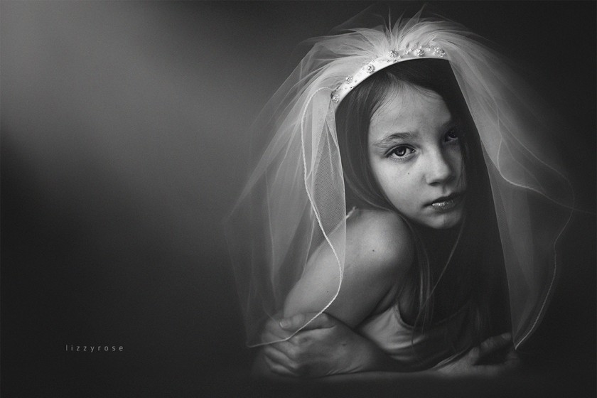 black and white photo of a girl wearing a veil by Lisa Furey