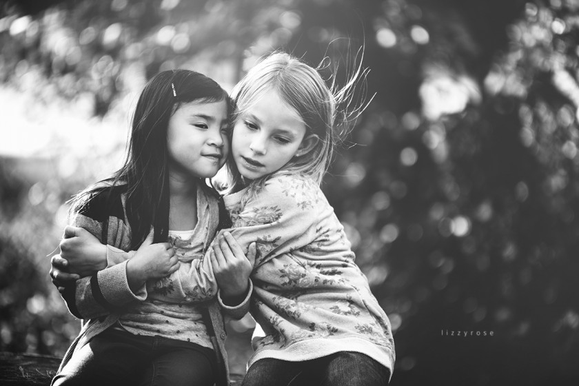 black and white photo of two girls by Lisa Furey