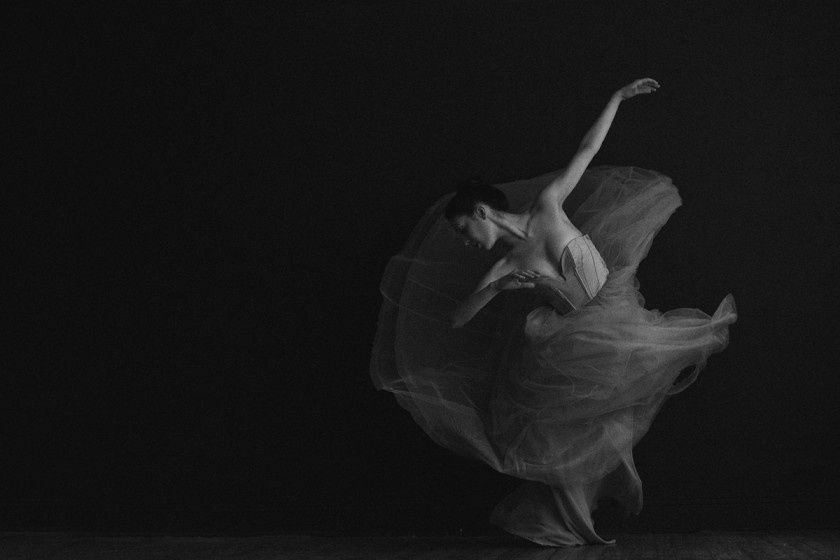 black and white photo of woman dancing by Sue Bryce