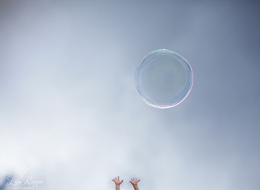 bubble floating in the air by Lisa Rappa
