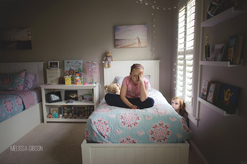 girl hiding in her sisters bedroom by Melissa Gibson